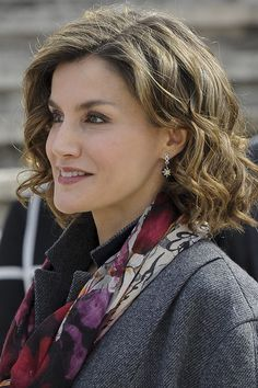 """Doña Letizia finished the outfit with her black star-burst drop earrings with diamond hoops. Queen Letizia at the """"Miguel de Cervantes: de La Vida Al Mito"""" opening exhibition. National Library, March 4, 2016, Madrid, Spain."""
