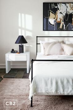 """Designer #KaraMann puts an art deco twist on the classic 19th-century metal bed frame. With thick stainless steel tubing, lustrous black finish and ivory linen, this bed feels solid and expensive. """"It's just so simple and elegant. It can go in so many different rooms,"""" explains Kara. """"I want it desperately."""" Bedroom Furniture, Home Furniture, Modern Furniture, Bedroom Decor, Decor Scandinavian, Stainless Steel Tubing, Metal Beds, Eclectic Style, Modern Bedroom"""
