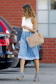 Jessica Alba wearing Chloe Baylee Perforated Satchel and Phyllis + Rosie Hammered Cuffs.
