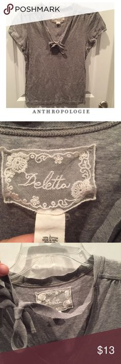 Anthropologie Deletta Gray V-Neck Tie Tee Anthropologie Deletta Gray V-Neck Tie Tee. Tie with the neckline. Can be worn as photographed or tied closer to the neck like a Choker. Gently worn. Great condition. Runs a little small. 18 inch bust. 23 inches long. Feel free to make an offer or bundle & save. Anthropologie Tops Tees - Short Sleeve