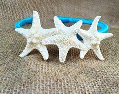 A personal favorite from my Etsy shop https://www.etsy.com/listing/225009425/starfish-hair-band-beach-wedding-mermaid