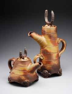 These pots really appealed to me!  I just like everything about them: the quirkiness, the design, the glaze and the playfulness!  They are by Mark Heimann.  There is some lovely and unusual ceramics on his site!  http://www.lostmtnclay.com/wild/viking_teapots/