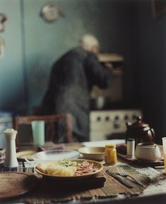 Julian Germain, photograph, 'Charlie in his kitchen stirring the gravy'