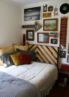 I love a good wall of eclectica!  That DIY rustic/chic chevron headboard made from 1x4s is pretty great.