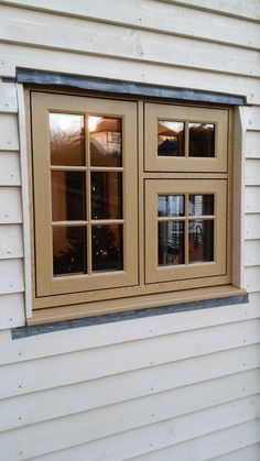 R9 window in English Oak into a weatherboarded cottage.