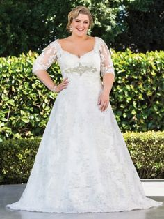 With stunning accents around the waist, this plus size bridal gown from the Glamour Plus collection by Roz La Kelin is sure to flatter your voluptuous figure!