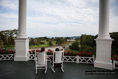 sitting on rocking chairs on grand hotel porch mackinac island michigan by paul retherford #grandhotelwedding #puremichigan