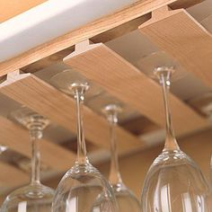 Watch this video to find out how to make an inexpensive rack to store and display wine glasses beneath the hanging cabinets in your kitchen, using standard T-molding available at home centers.