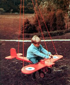 Any young pilot can bank, dive, and climb in this plane that swings from a sturdy tree branch.  It is cut from plywood, then sanded and painted.  Nylon rope is threaded through pulleys at strategic points
