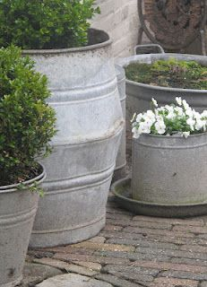 i really love the galvanized look..... and containers mean no tilling!