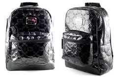"""Black Patent Leatherette - Hello Kitty Backpack  Zippered backpack featuring Hello Kitty  Shiny black patent faux leather with embossed Hello Kitty design  Hanging loop and carrying strap on top of the bag  Padded back and adjustable shoulder straps for comfort  Zipper front pouch with pen holder  Metallic Hello Kitty logo in front  Material: Easy to clean vinyl  Size: 12"""" x 16"""" x 6"""" (30 cm x 40 cm x 15 cm)"""