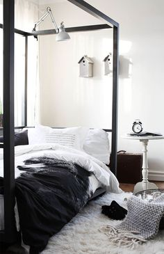 adjustable desk lamp attached to a canopy bed, tall white night stand, fur rug, wool blanket, wire basket