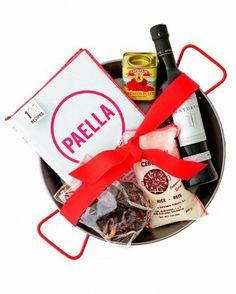 Hostess Gift ideas: paella-kit, other ethnic themed basket, handmade votive candles, etc. See Hostess Gift ideas found on MarthaStewart.com