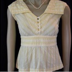 Anthropologie Floreat yellow top size 2 Anthropologie Floreat yellow meridian seersucker top, size 2. Beautiful & in like new condition. Cute nautical style, banded waist and sailor collar, piped waistband for a flattering nipped in silhouette. Anthropologie Tops Blouses