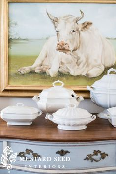 How many cow prints can i have before it gets wrird. Ironstone Haul - Miss Mustard Seed - Love the look of a collection of tureens - all white. French Decor, French Country Decorating, Cow Painting, Miss Mustard Seeds, Cow Art, Farmhouse Chic, French Farmhouse, French Cottage, Shabby Cottage