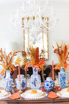 Orange and Blue Fall Tablescape Thanksgiving Table Settings, Thanksgiving Tablescapes, Thanksgiving Decorations, Happy Thanksgiving, Thanksgiving Traditions, Blue And White Vase, Chinoiserie Chic, Fall Table, Fall Home Decor