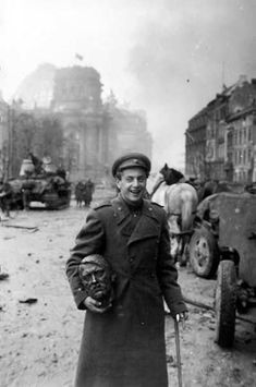 Russian with Hitler's (statue) head in his arms. 1945 World War II