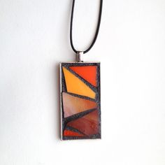 "Gorgeous abstract style orange stained glass mosaic pendant. Silver-plated base with 18"" waxed cotton cord. Hand created by NiagaraGlassMosaics on Etsy"