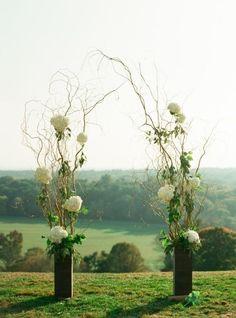 modern yet rustic wedding arch