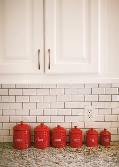 white subway tiles with chocolate grout: tiling my own backsplash. White Subway Tiles, Subway Tile Kitchen, Kitchen Backsplash, Kitchen Redo, Kitchen Remodel, Kitchen Dining, Red Canisters, Kitchen Canisters, Antique White Cabinets
