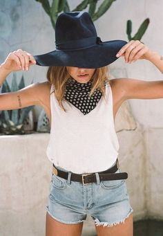 High waisted Shorts. Crop Muscle Tee. Wide Brim Hat.