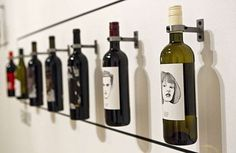 """A wall of bottles demonstrates the artistry of wine labels at the """"How Wine Became Modern"""" exhibit at the San Francisco Museum of Modern Art in San Francisco, Calif., on Monday, November 15, 2010. Photo: Laura Morton, Special To The Chronicle"""