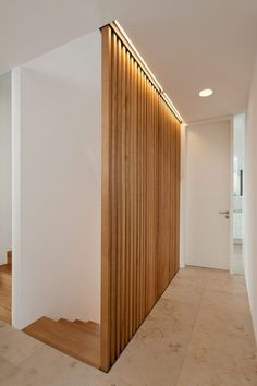 Wooden slats as bannister. Wohnhaus W. by Berschneider+Berschneider Architekten. lovely wood detail to allow light to transfer through into the lower staircase What a simple yet amazing way to treat a stairway!