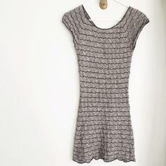 """{free people} grey bodycon dress Grey knit bodycon mini dress by Free People.   ➳ size XS ➳Worn once but NOTE FLAWS: faint discoloration on back left shoulder pic 3, area where a small hole was mended pic 4 - priced accordingly ➳ this dress is SHEER, I'm wearing a nude colored body slip in the photos. It's also short-I'm 5'2"""" for ref.  ➳ 60% cotton 40% rayon  please note: ❥I do not trade ❥everything in my closet is pre-owned and not in unworn condition unless otherwise stated.  ❥ask…"""