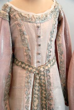 A close up of one of the last grand duchesses' of Russia's early court dresses, early 1900s.