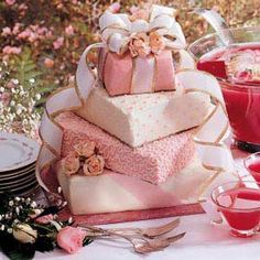This cake will be sure to delight all of your guests at your shower. Everything can be made ahead and assembled the day of.—Taste of Home Test Kitchen, Greendale, Wisconsin Cool Wedding Cakes, Beautiful Wedding Cakes, Beautiful Cakes, Amazing Cakes, Gift Box Cakes, Gift Cake, Christmas Gift Wedding Cake, Pink Christmas, Pink Frosting