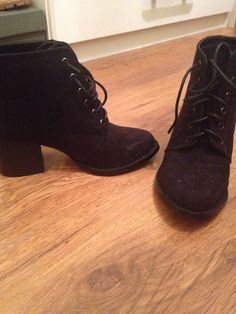 Wedged black boot