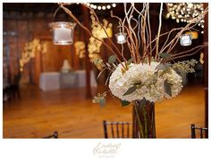 Tall, rustic reception arrangement made with white hydrangea, pink hypericum berries, seeded eucalyptus and curly willow, Casie Webb Designs casiewebbdesigns.com Photography: Lindseymichellephotography.com