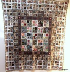 Simple granny squares, but the use of colors in bordering  assembly are what make this so beautiful..