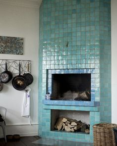 Love this tiled fireplace! I bet those tiles trap heat and then radiate it all night, helping keep the place toasty and conserving energy :)