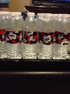 Used Mickey Mouse duct tape to decorate the water bottles.