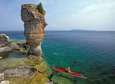 A sea kayaker navigates the rocks around Flowerpot Island in Ontario's Fathom Five National Marine Park. Located on Lake Huron, Fathom Five is a marine conservation area popular with divers and paddlers and for its island boat cruises Canada National Parks, Parks Canada, Canada Eh, Great Places, Places To See, Beautiful Places, Flowerpot Island, Gros Morne, Ontario Parks