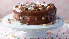 Covered in chocolate icing and decorated with sweets, this cake is perfect for a children's birthday party.
