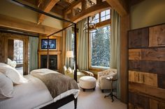 """Very nice bedroom for many reasons - wood beams, large window """"with a view,"""" comfy stylish bed and on and on..."""