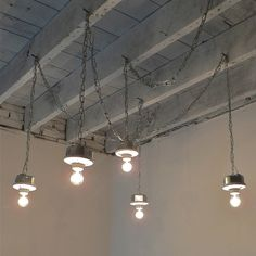 love the wooden ceiling and industrial lights