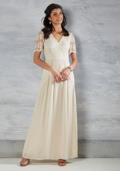 The time has come for you to make your debut down the aisle in this ivory gown! As you make your entrance in the intricate floral embroidery, sheer half sleeves, and the elegant open back of this boho-inflected dress, the present moment looks absolutely picture perfect.