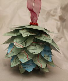 Turtles and Tails: Pinecone Map Ornament..I am thinking you can make the pine cone with paper bag or other types of paper.... cute:]