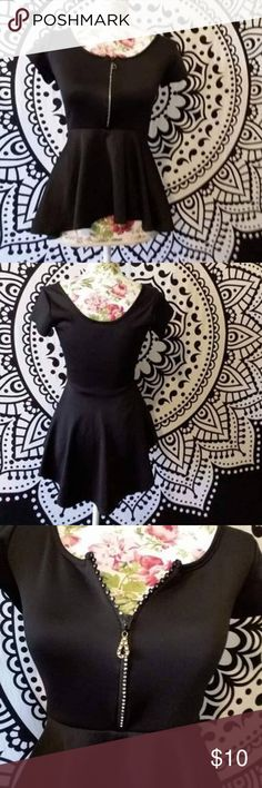 Rue21 Black Peplum Top Excellent condition. Has rhinestone zipper in front which you can see a close up of in photo 3. Classy yet affordable. Measurements on request and all offers will be considered. Bundle to save big!! Rue21 Tops Blouses