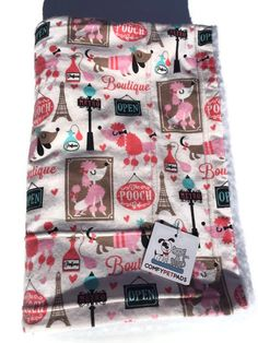 Adorable Poodles and Doxie Dachshunds in Paris at the Pooch Boutique are surrounded by the Eiffel Tower themed flannel blanket. Soft and lightweight, its made of Flannel and craft Sherpa. Use as a throw for your pet or a great gift for any child. If you love Poodles and love Paris and need that perfect birthday gift for the poodle lover, or something for a nursery, than this blanket is perfect! Makes a great baby shower gift, gift for any child or a nice blanket for your pet. Also makes a…