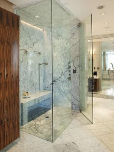 Stunning master bathroom with floor to ceiling frameless glass shower with marble shower surround and marble shower bench. Dream Bathrooms, Beautiful Bathrooms, Modern Bathroom, Modern Shower, White Bathrooms, Marble Bathrooms, Master Bathrooms, Small Bathrooms, Hells Kitchen