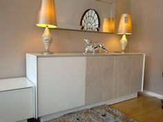 Book sideboard in white glass with one door in white glass and two doors with ceramic line fronts.