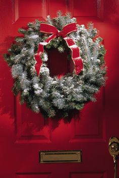 Door wreaths come in a variety of sizes. The most common size is the 22-24 inch Christmas wreath. This is a great size for a standard size front door and looks fantastic. If you have a larger entry area, door wreaths are available in a slightly larger 28-inch size, a 32-inch size, and even in a 36-inch diameter. Side Note: The size of a door wreath refers to the outside diameter of the wreath.