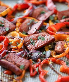 This sheet pan sausage and peppers is our most utilized weeknight meal! It's super easy and delicious and can be made in no time at all. It's a hit with everyone - you can serve it on its own or with whatever side dish you love!   used TJ's siracha garlic bbq sauce