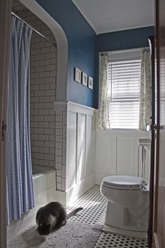 """Take a tour through the """"Itty Bitty Bungalow"""": A DIY renovation - swiss. Wainscoting Stairs, Wainscoting Bathroom, Bathroom Floor Tiles, Wainscoting Ideas, Black Wainscoting, Painted Wainscoting, Small Bungalow, Bungalow Homes, Bungalow Interiors"""