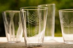 Delicately hand-etched, each mouth-blown glass reveals a unique pattern quietly celebrating nature. Adorned with simple leaf and stem patterns, these Roost Etched Botanical Glasses bring elegance to any table.  ➽ Available at ShopNectar.com