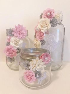 paper flower centerpieces Beautiful mason jars decorated with paper flowers. You can customize what color flowers you want. Great for centerpieces or gifts! Most popular for h Paper Flower Centerpieces, Paper Flowers Diy, Shower Centerpieces, Wedding Centerpieces, Diy Paper, Paper Crafts, Mason Jar Crafts, Bottle Crafts, Glitter Mason Jars